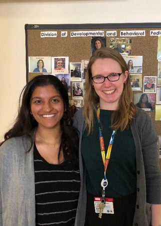 Pooja and Hannah Volunteer