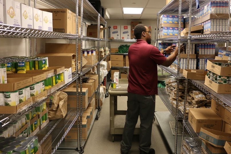 employee working in the food pantry pictured from behind