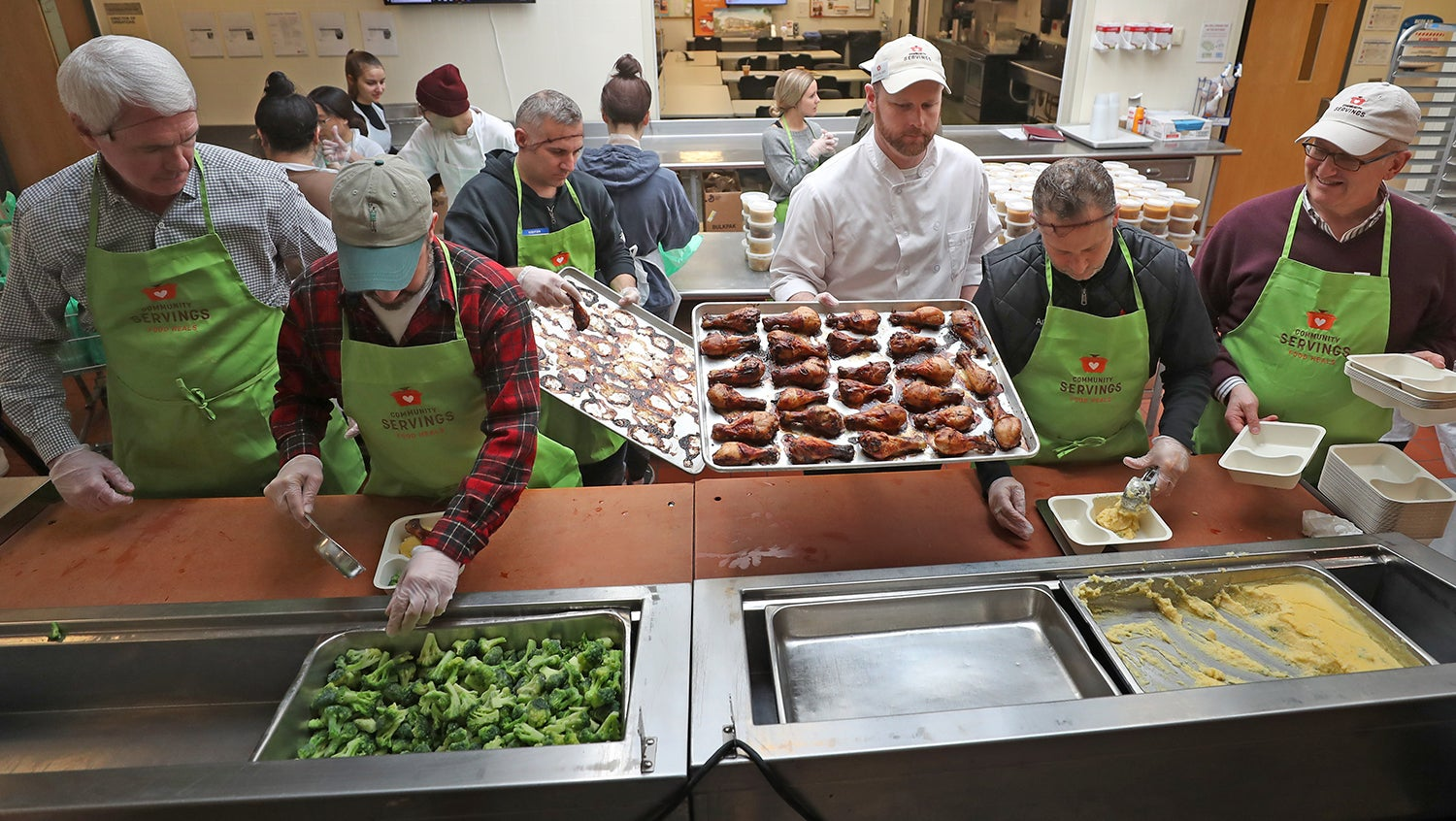 Community Servings volunteers prepare medically tailored meals to be delivered to patients with complex dietary needs.