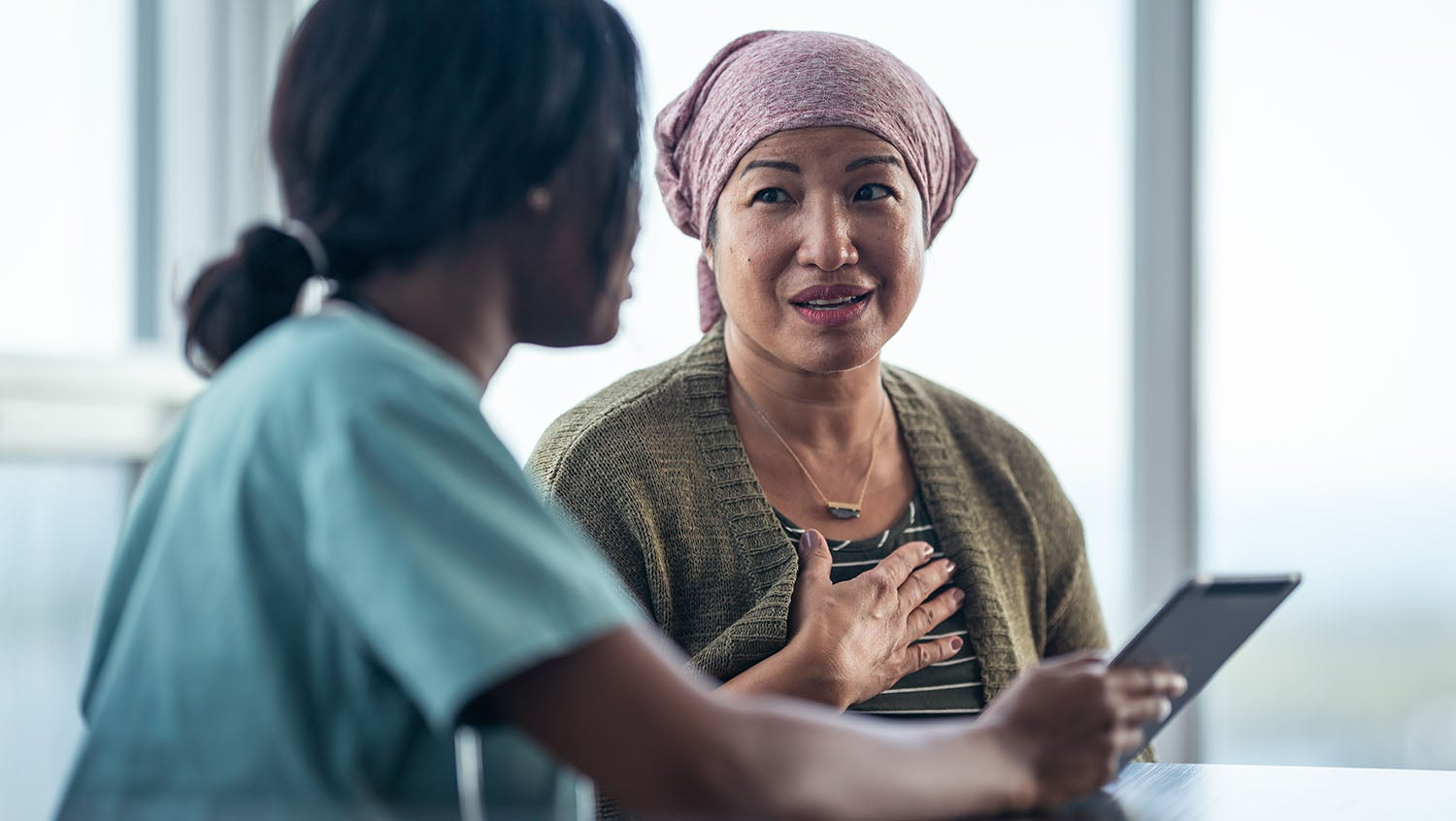 cultural humility vs. cultural competence, patient and doctor talking in hospital