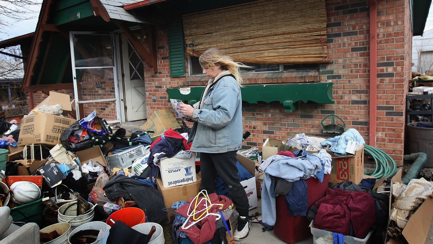 pregnant woman housing eviction with boxes outside her home