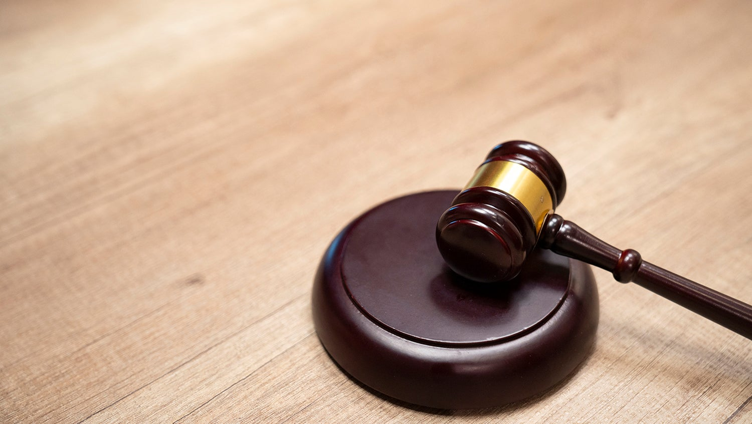 a judge's gavel sits on a table
