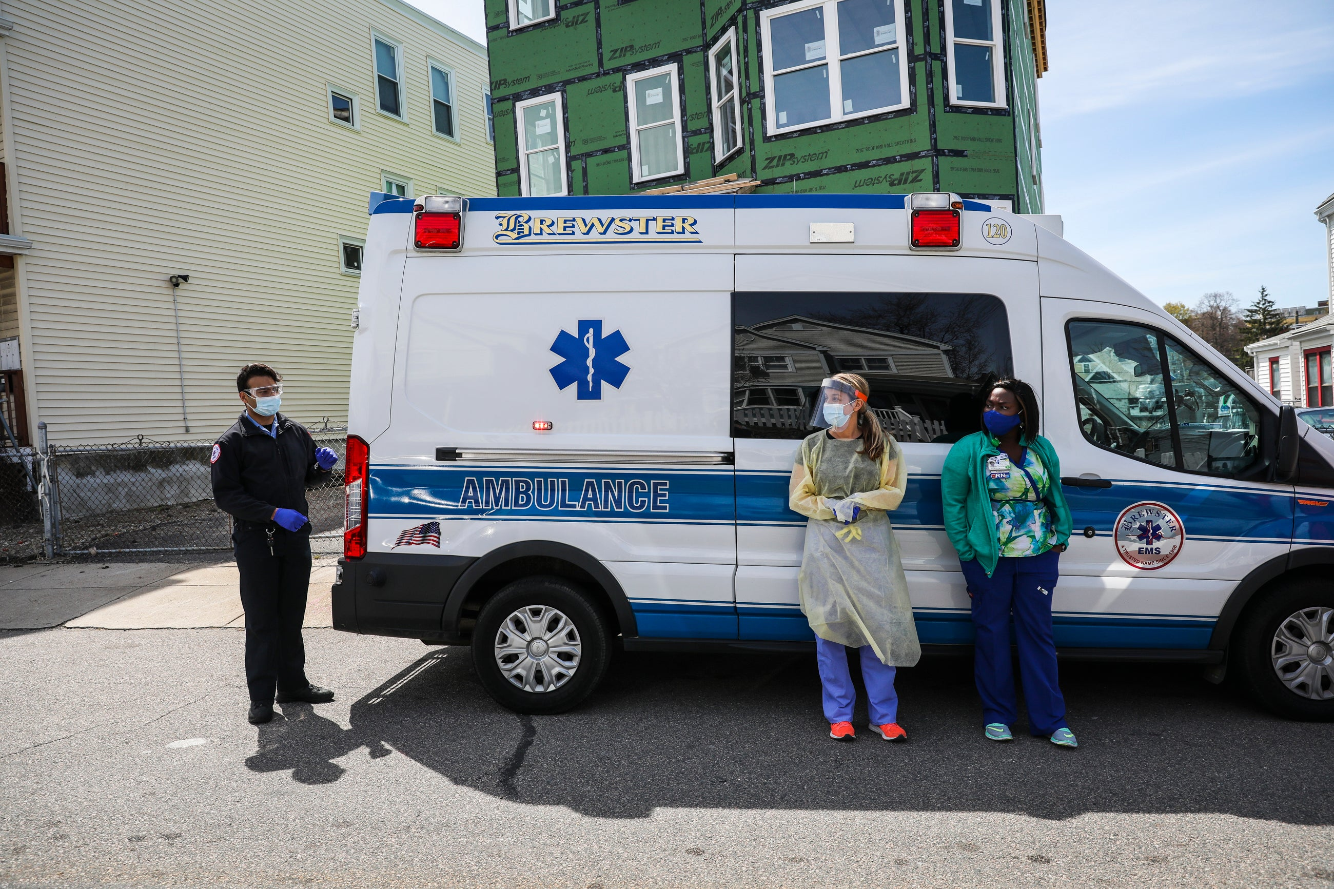 BMC providers from the department of pediatrics in front of their mobile clinic, housed within in an ambulance