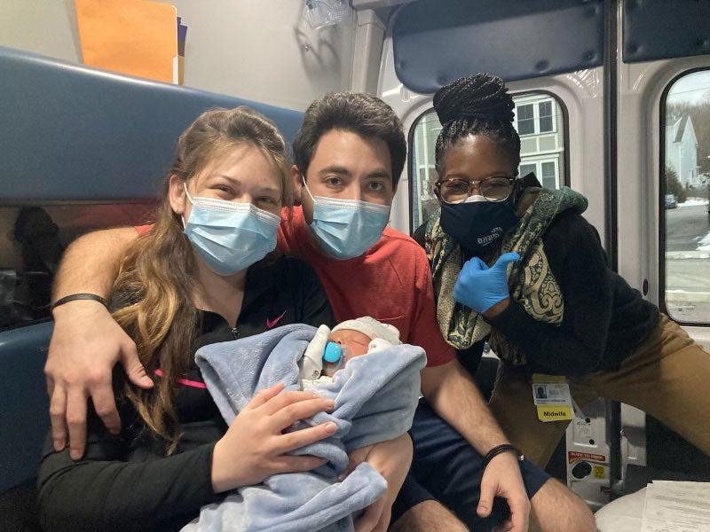 bmc postnatal care mobile unit program shows midwife pose with new parents