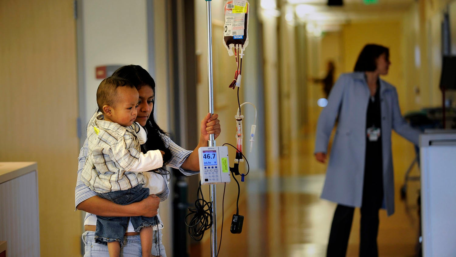 child and adult with sickle cell disease type sickle cell anemia in a hospital
