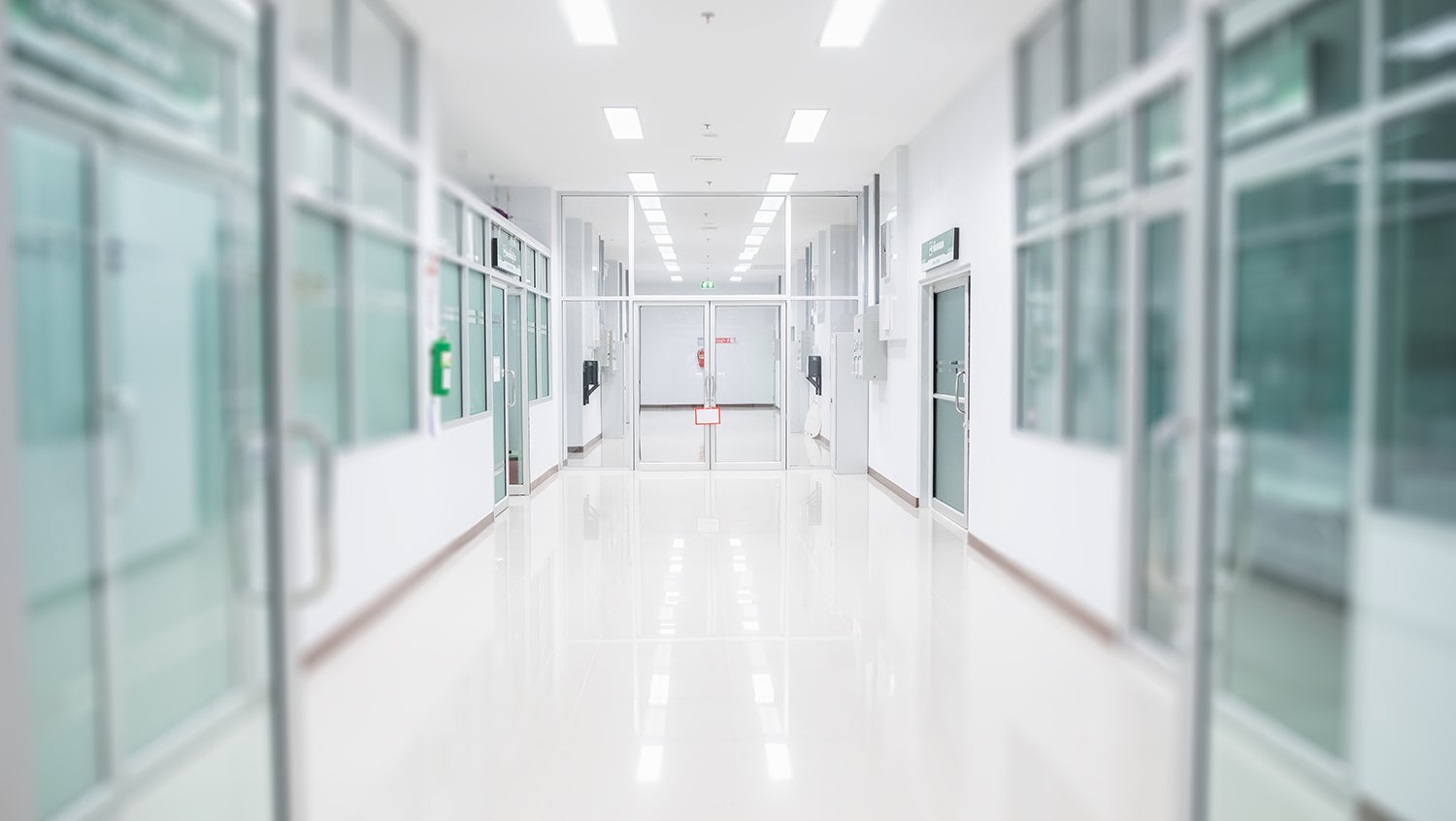 Empty and clean white hospital hallway