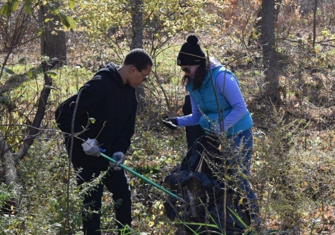 Cleaning up a nature trail with the Mass Audobon Society