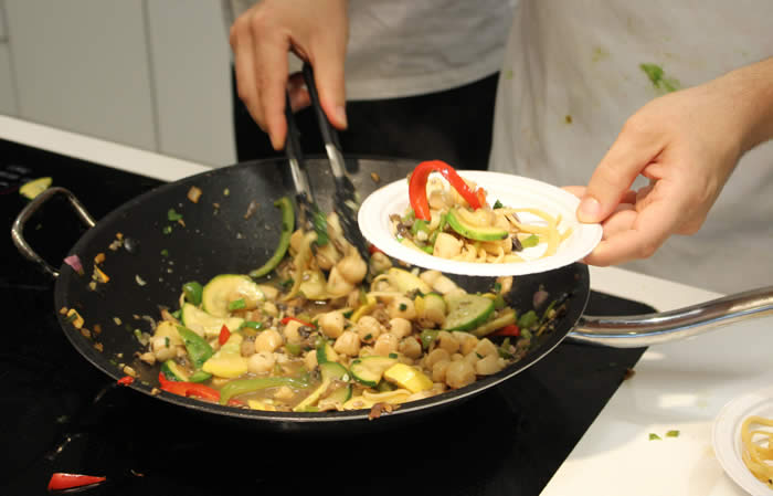 a person stir frying