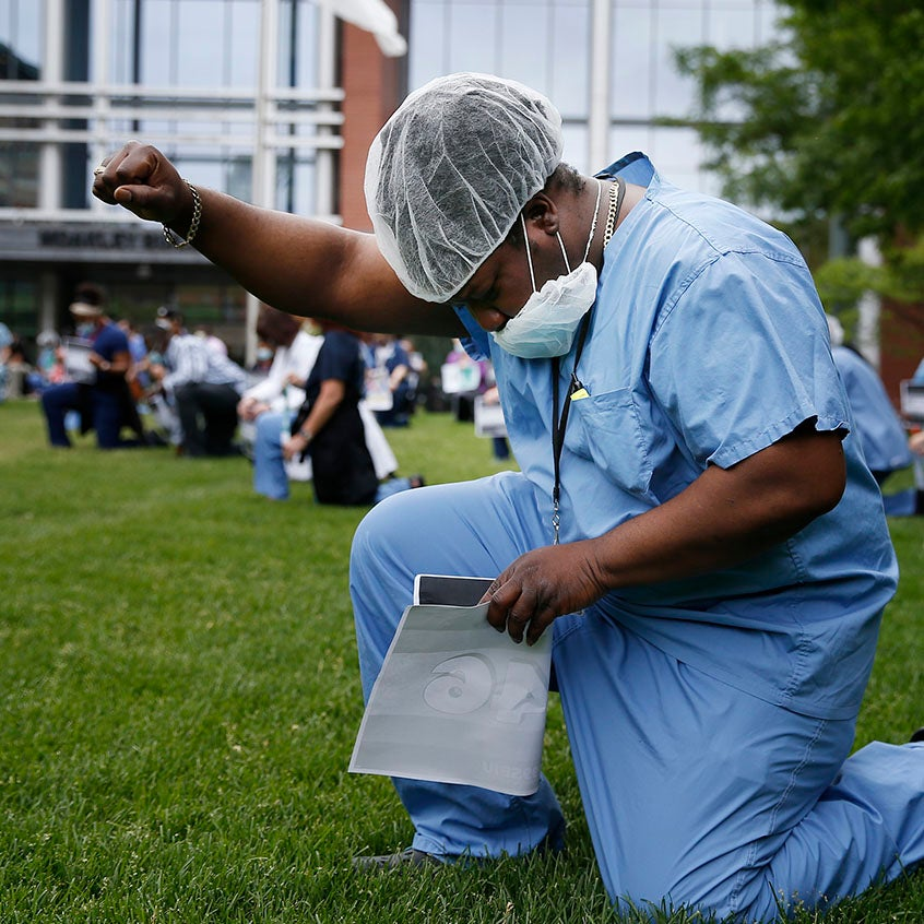 doctor kneels in black lives matter protest at boston medical center