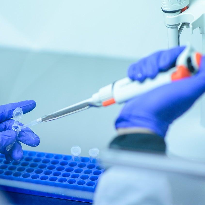 Investigator handles COVID-19 biorepository samples