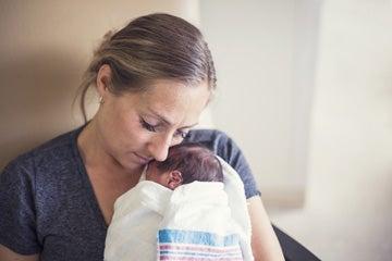 A mother holding a newborn