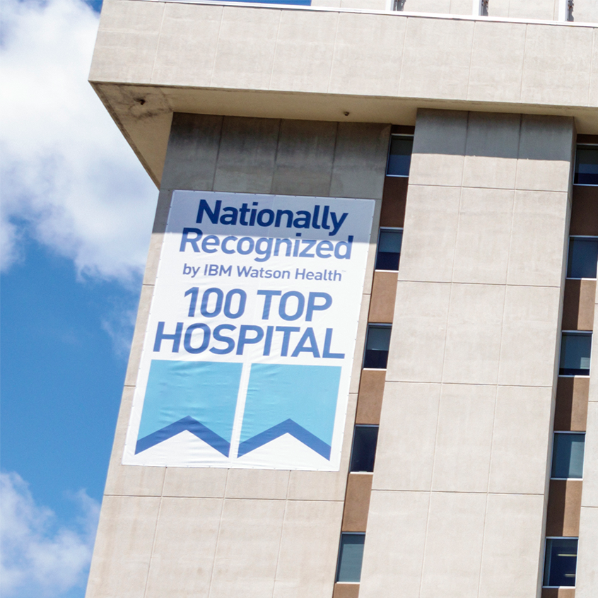 top 100 hospital rankings poster on hospital exterior