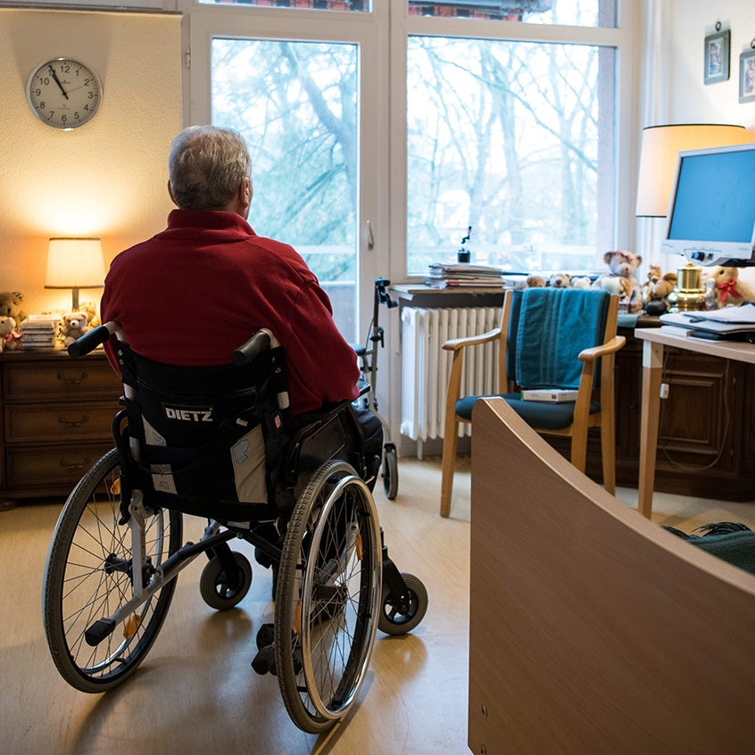 nursing home person in wheelchair isolated during covid-19 pandemic