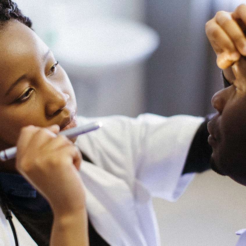 doctor looking at pupil size in patient