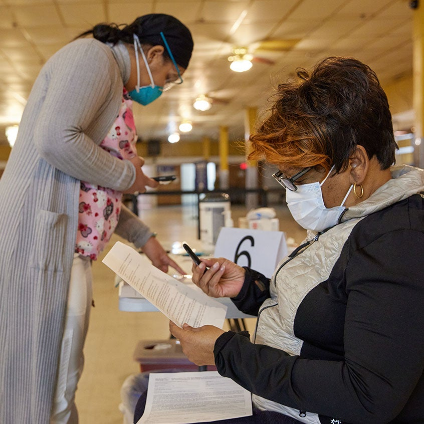 black woman getting covid-19 vaccine at dorchester community vaccination site